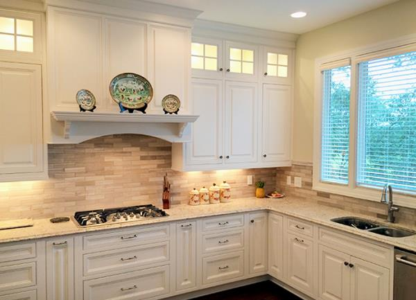Custom Wood Hood Flanked by Lighted Stacked Wall Cabinets