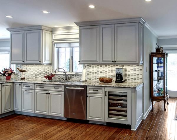 Solid Color, Raised Panel Doors and Crown Moulding Create Traditional Design
